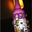 The first thing you notice when you pick up a bottle of Rogue Voodoo Doughnut Ale is the girly pink bottle. It is very pink....